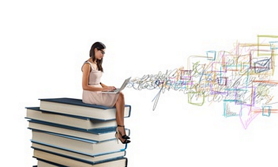 Woman with laptop, sitting on large pile of books using wifi