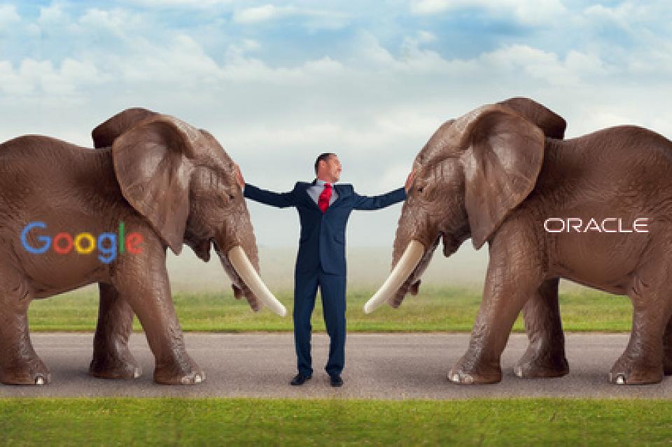 Oracle elephant versus Google elephant with man pushing them apart