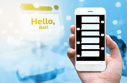 Chat bot and future marketing concept , Man hand holding mobile phone with automatic chatbot message screen with blue blur mini robot with Hello bot text message abstract bokeh background .flare light