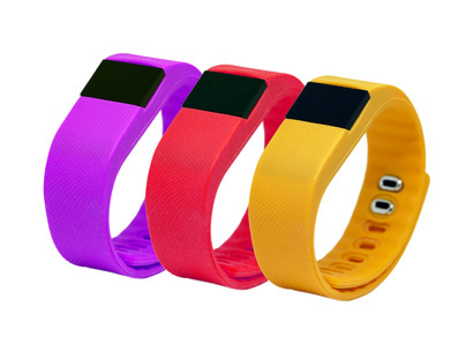 3 brightly colored Fitbits