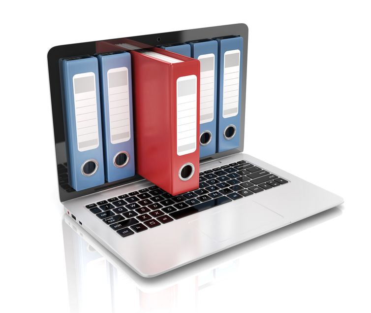 file in database - laptop with ring binders