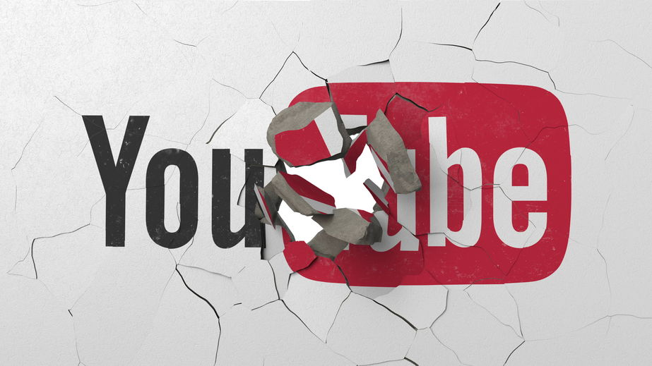 Breaking wall with painted logo of YouTube. Crisis conceptual editorial 3D rendering