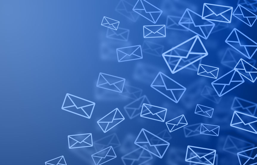 a flurry of envelopes on a blue background