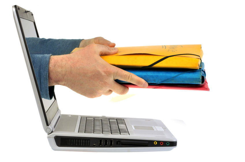 Hands holding out folders through a laptop screen
