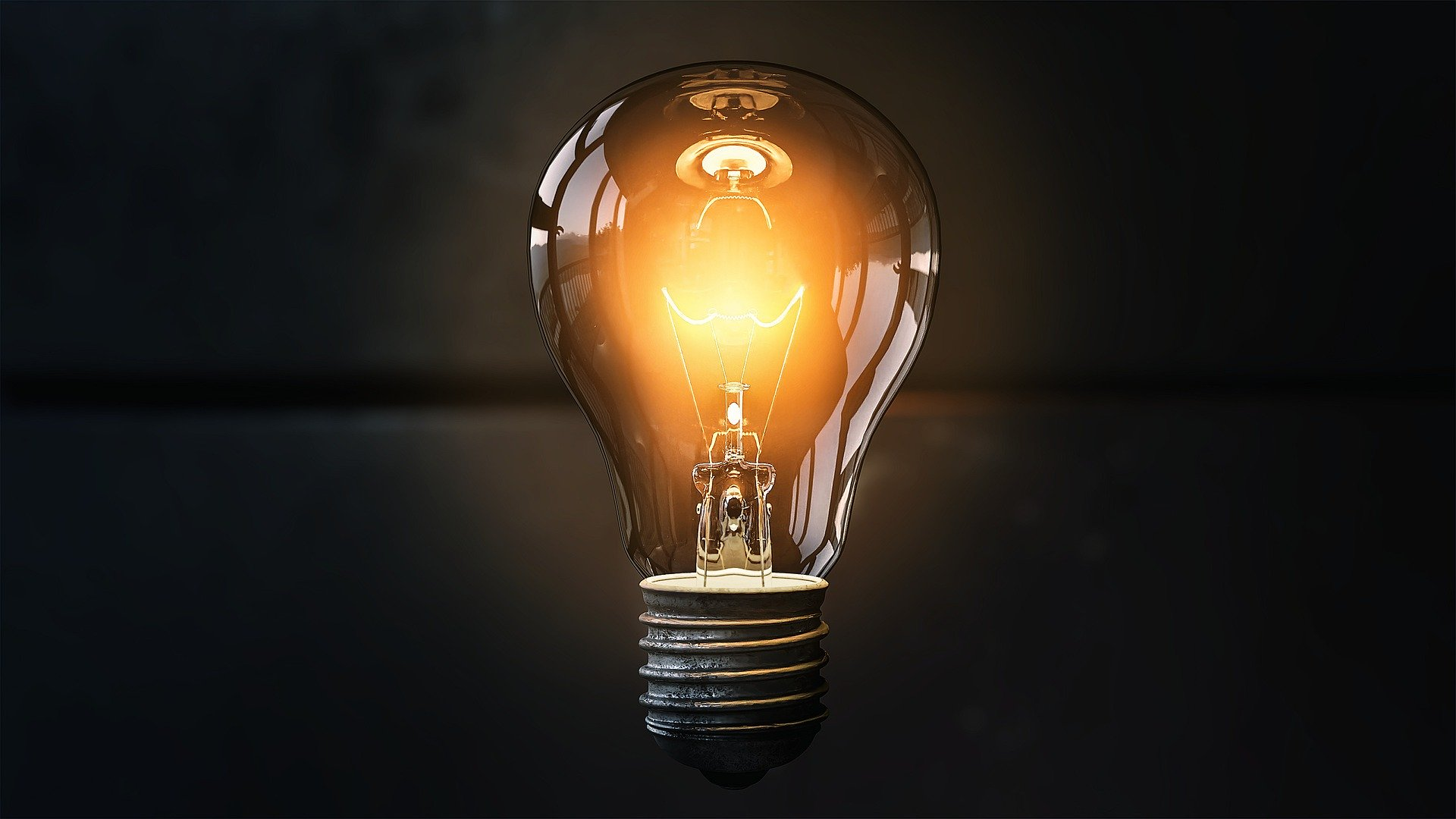 A single light bulb, illuminated