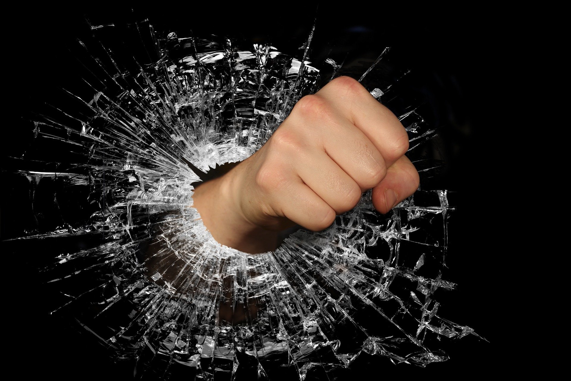 Fist punching through glass