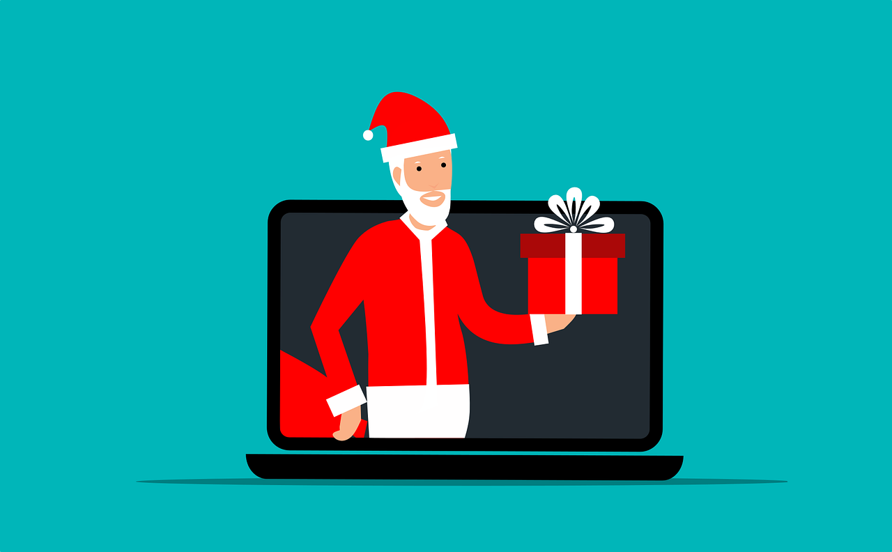 Santa holding a gift from a laptop screen