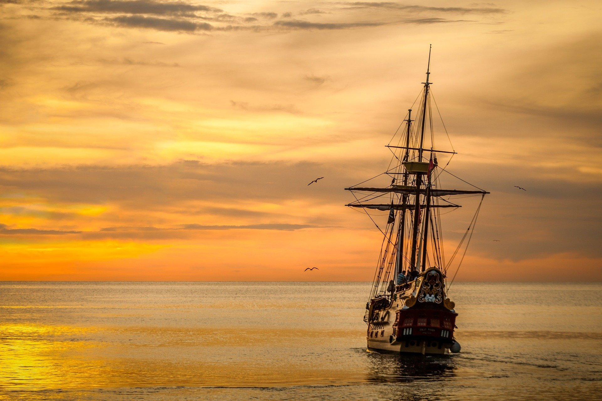 Old ship sailing into the sunset