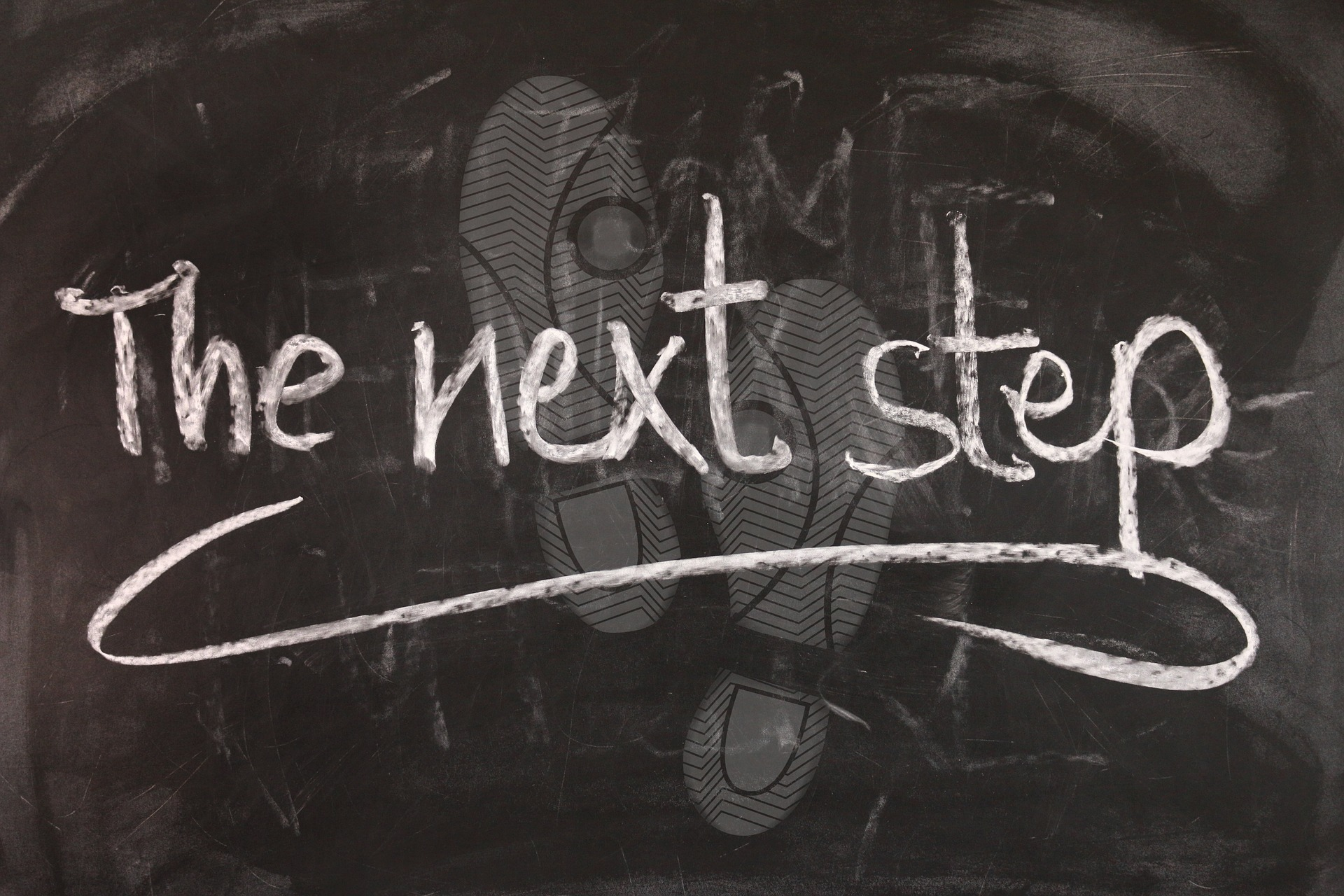 The next step written on a chalkboard