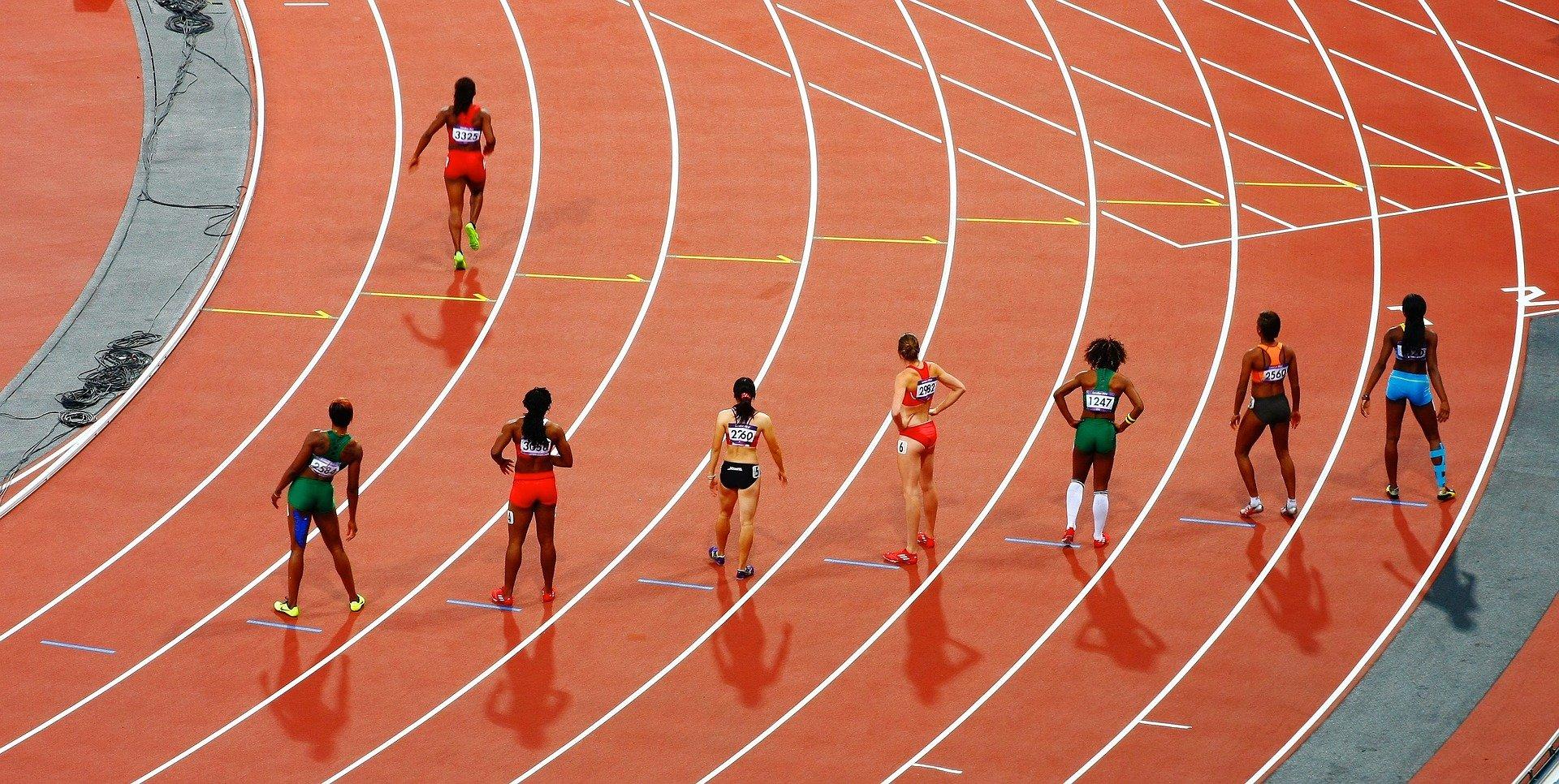 Women running a race on a track