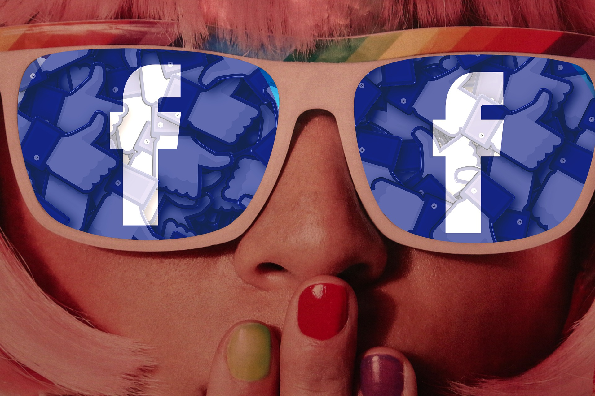 woman wearing sunglasses with facebook logo on lenses